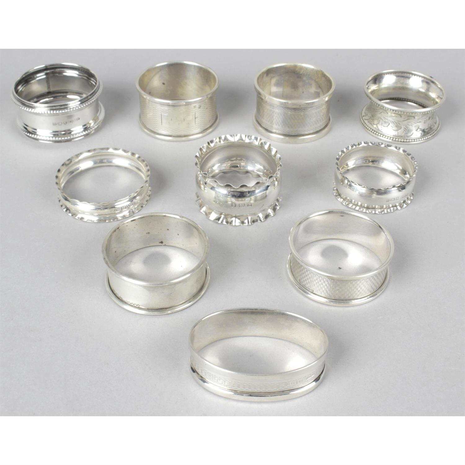 A collection of ten assorted mixed silver napkin rings.