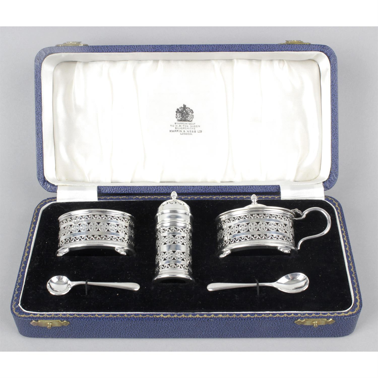 A cased mid-20th century silver three piece condiment set, by Mappin & Webb.