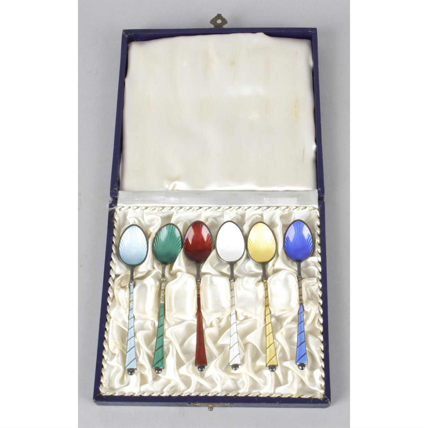 A cased set of Danish sterling silver and enamel coffee spoons, together with a 1930's silver