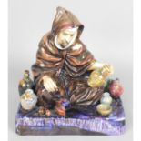 """Royal Doulton Figure """"The Potter"""" and a Staffordshire pottery pen holder """"The Turk """","""