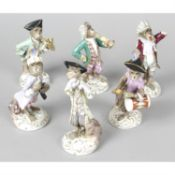 A group of six porcelain monkey band figurines with Meissen style marks.