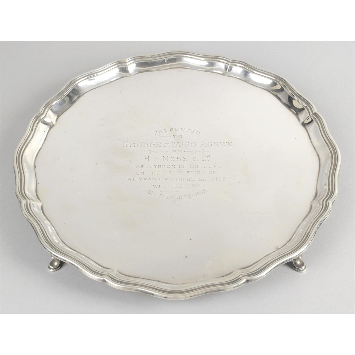 A large George V silver salver, with presentation engraving.