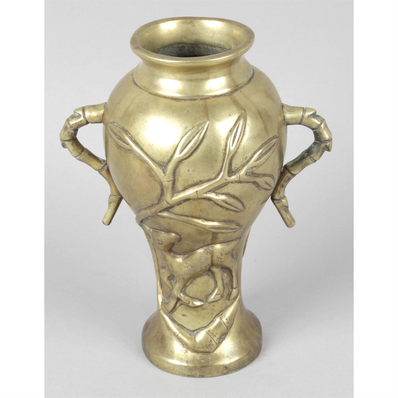 An Oriental bronze vase.