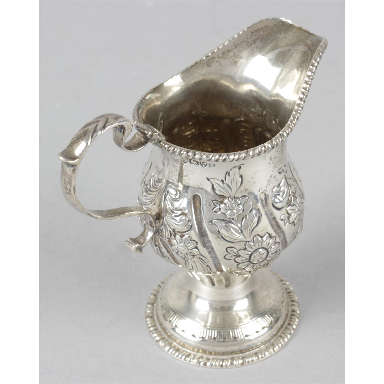 An Edwardian silver floral embossed pedestal cream jug. - Image 2 of 3