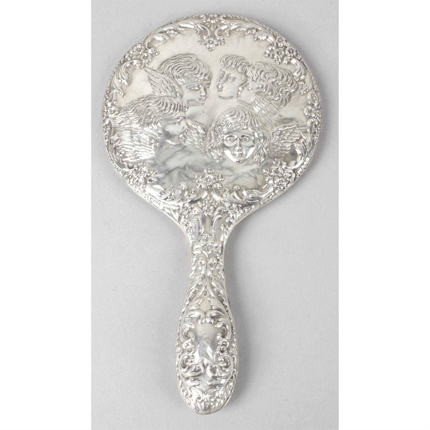 A modern silver mounted hand mirror; together with a cased silver mounted military brush and comb