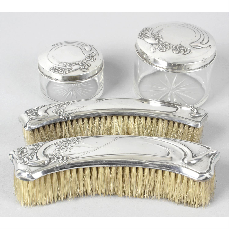 An Italian Art Nouveau style silver mounted dressing table set.