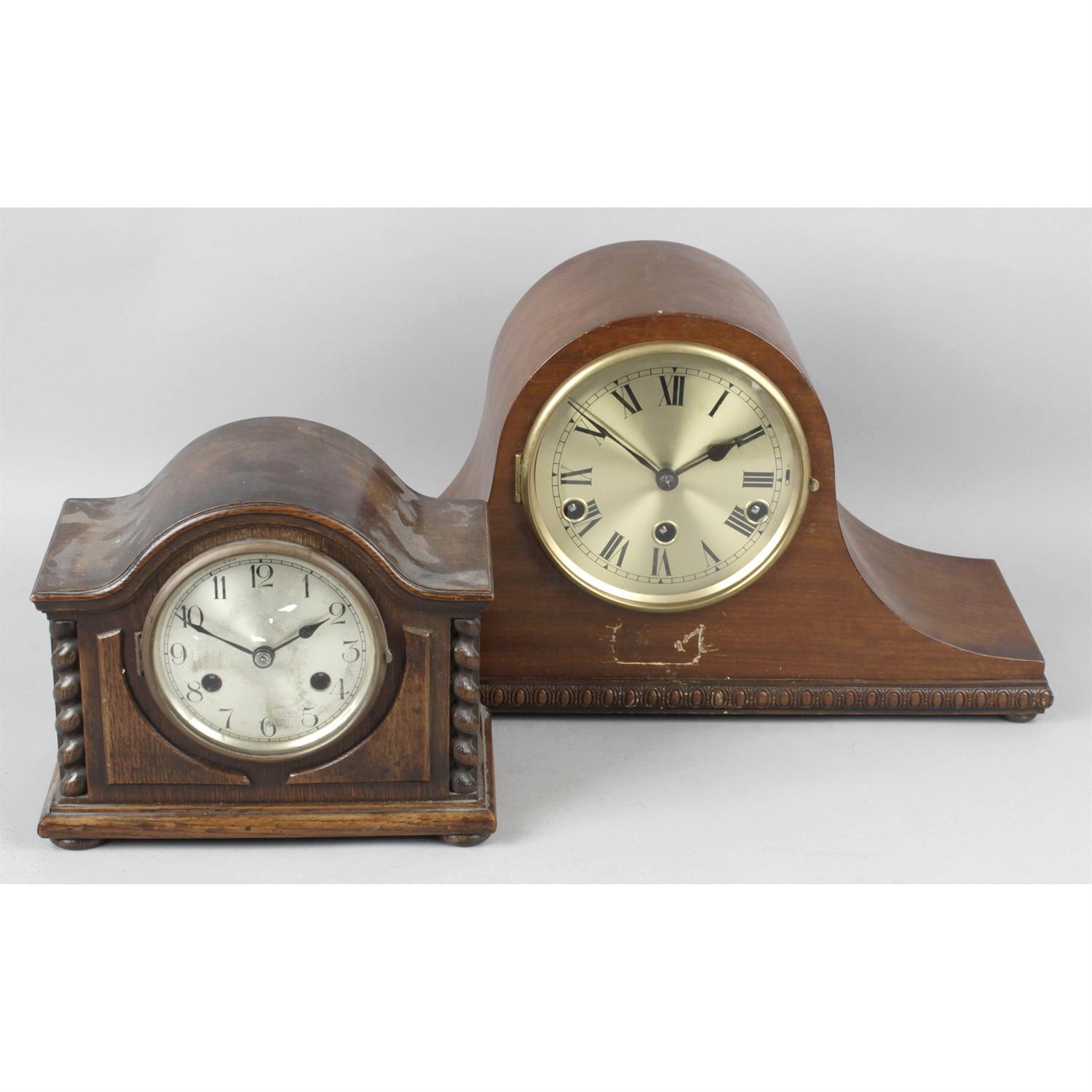 A reproduction wall hanging lantern style clock together with two mahogany cased mantel clocks.