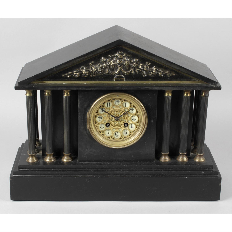 A Victorian black slate mantle clock