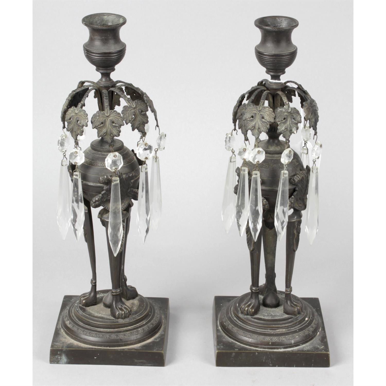 A pair of regency bronze candle sticks.