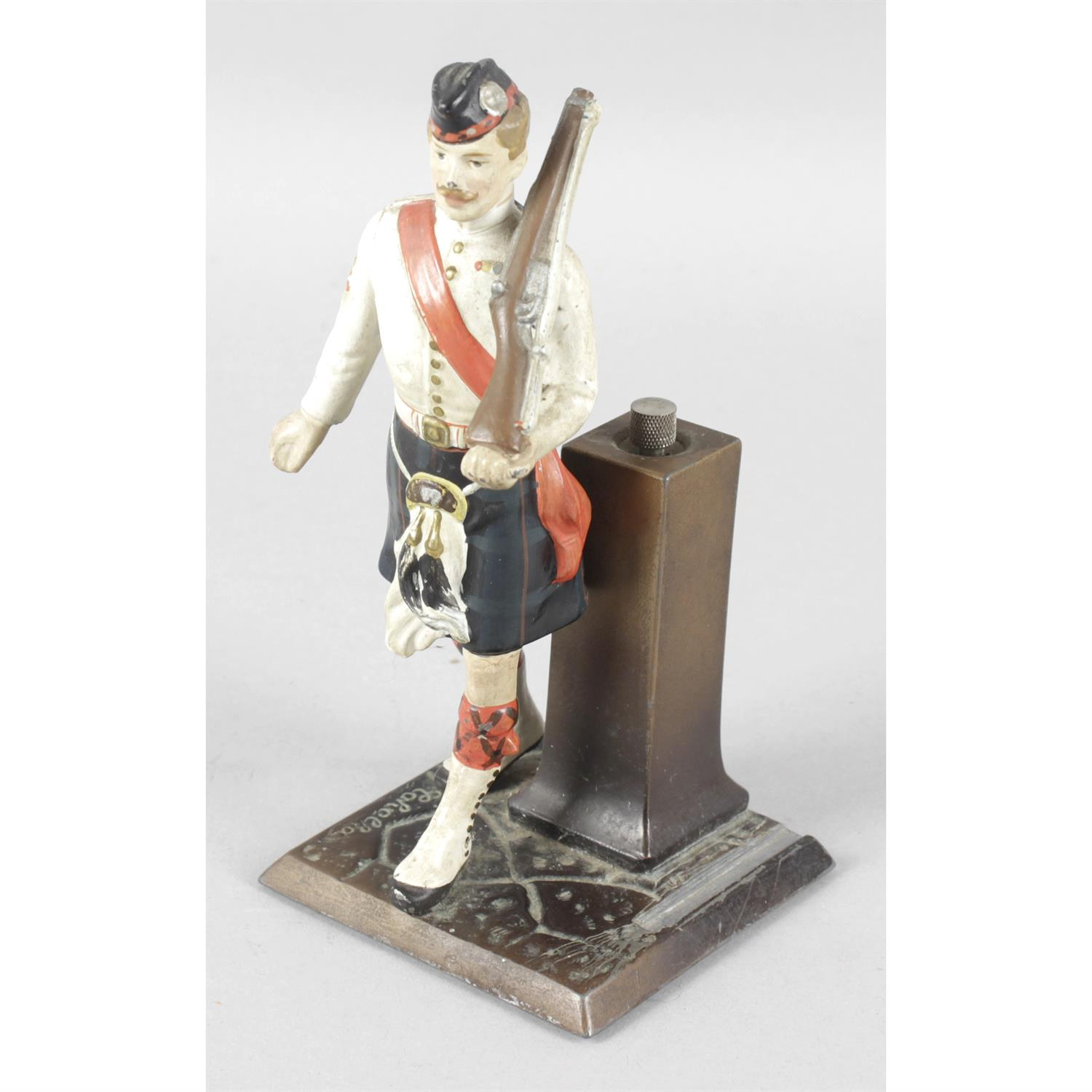 Austrian bronze match striker modelled as a Sergeant of the Scots Guards and other figures.