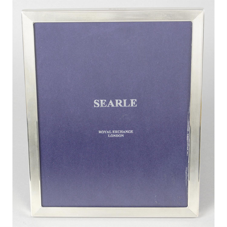 A modern silver mounted photograph frame.