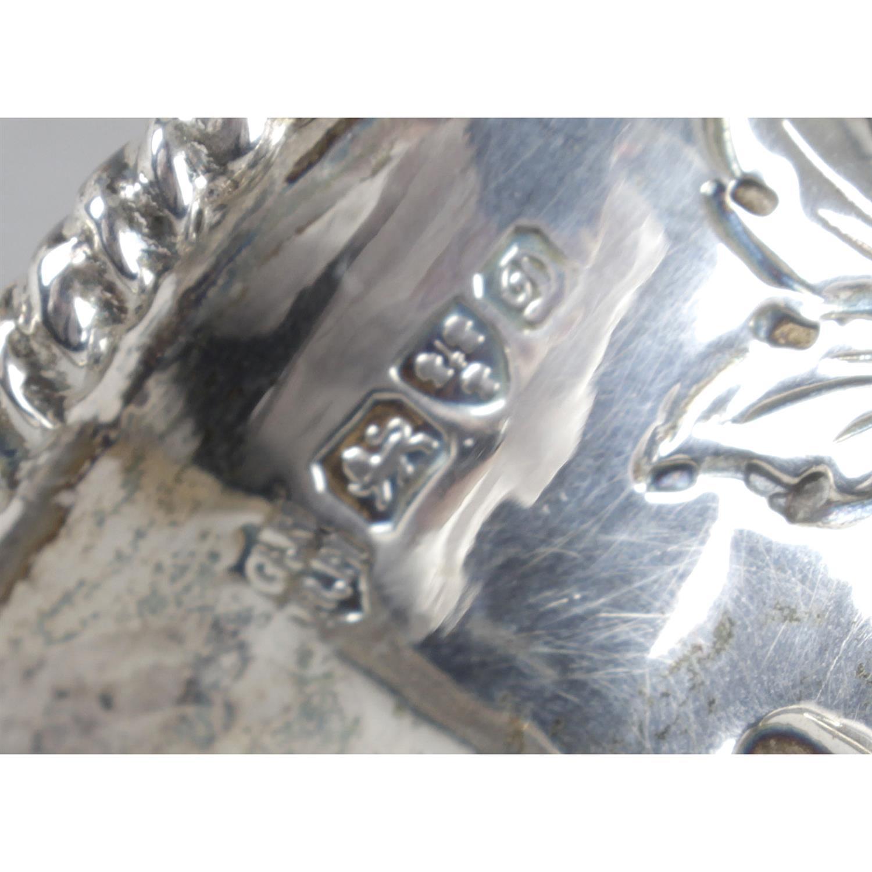 An Edwardian silver floral embossed pedestal cream jug. - Image 3 of 3