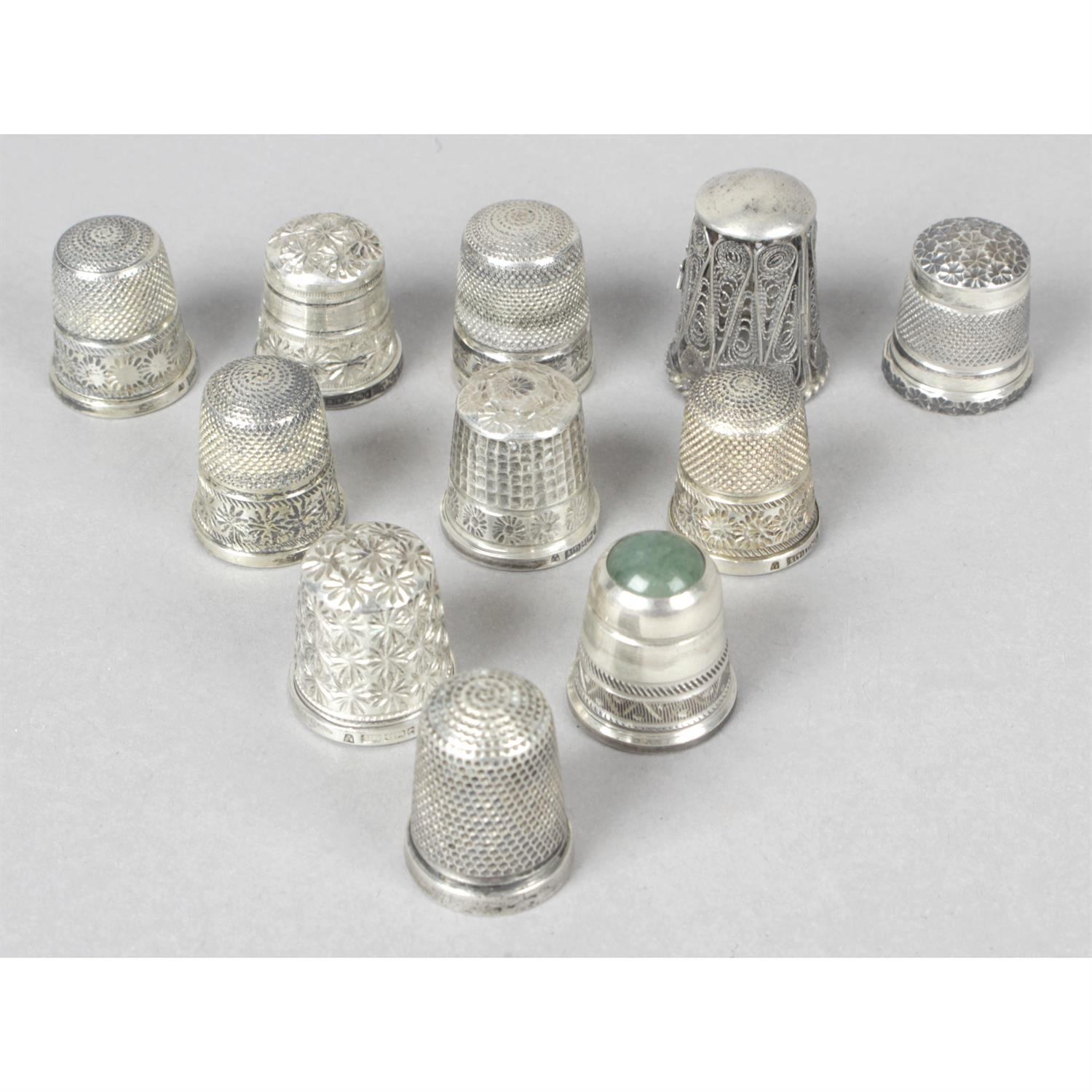 A collection of eleven silver sewing thimbles.