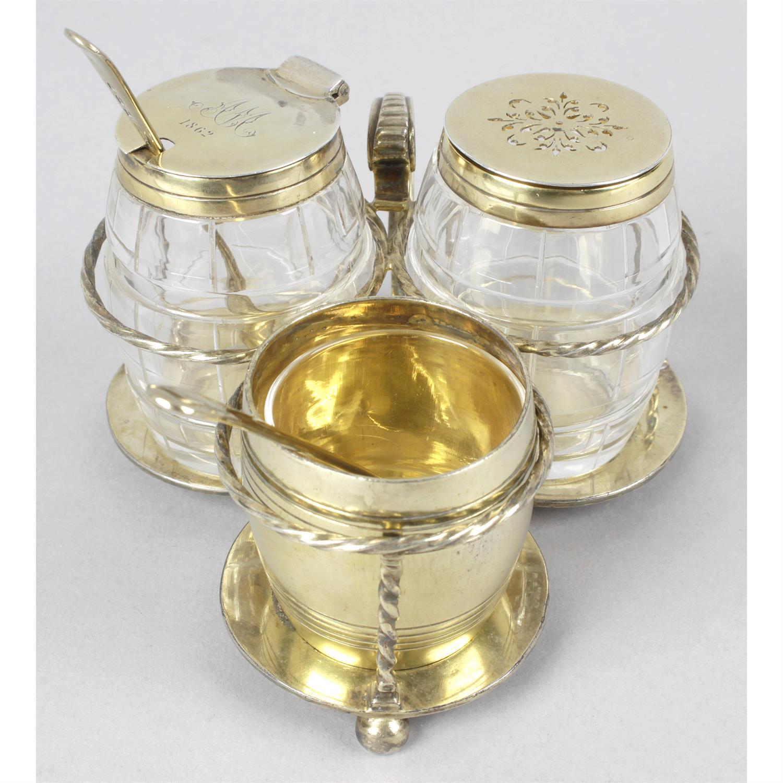 A mid-Victorian silver-gilt and glass cruet set.