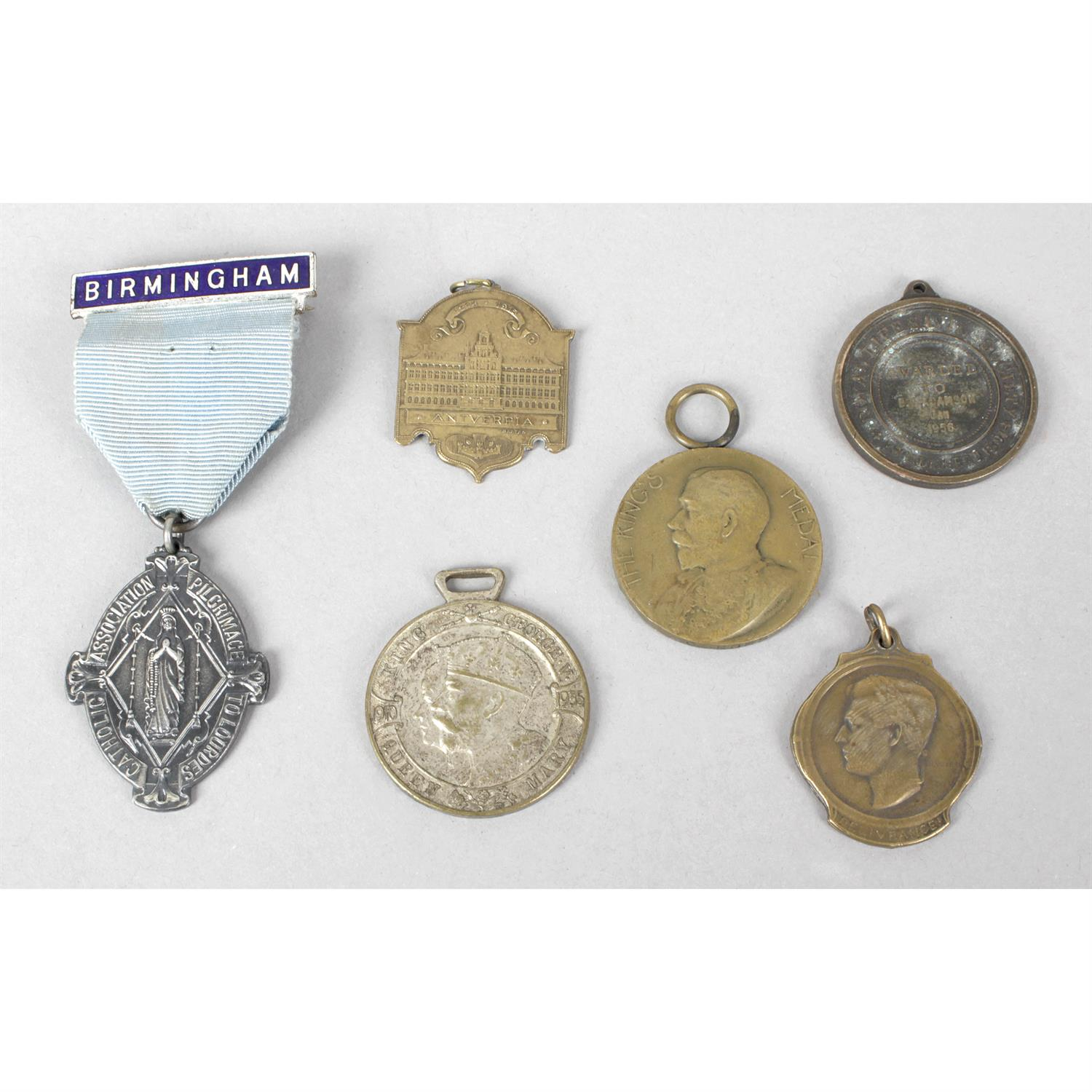 A small mixed selection of base metal badges and bronze medals.