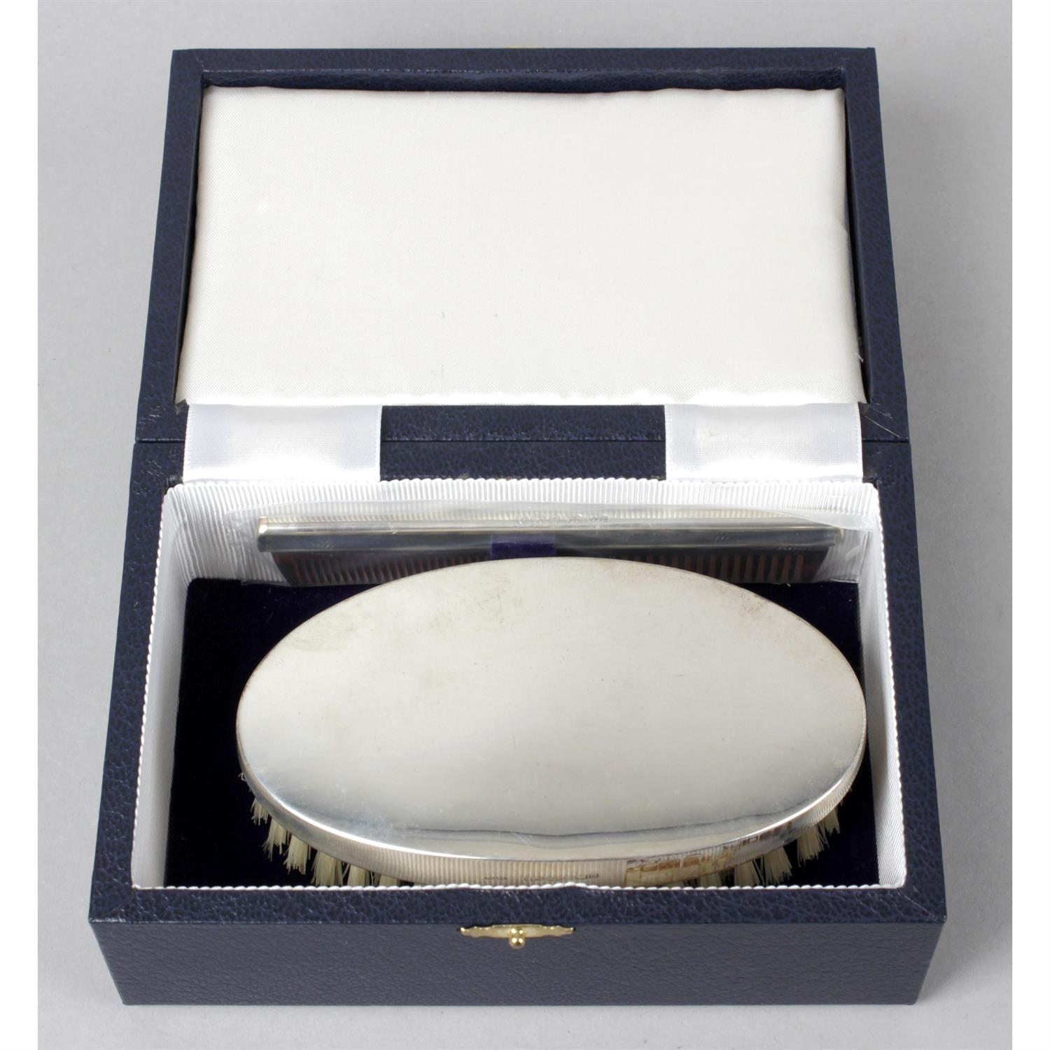 A modern silver mounted hand mirror; together with a cased silver mounted military brush and comb - Image 2 of 2