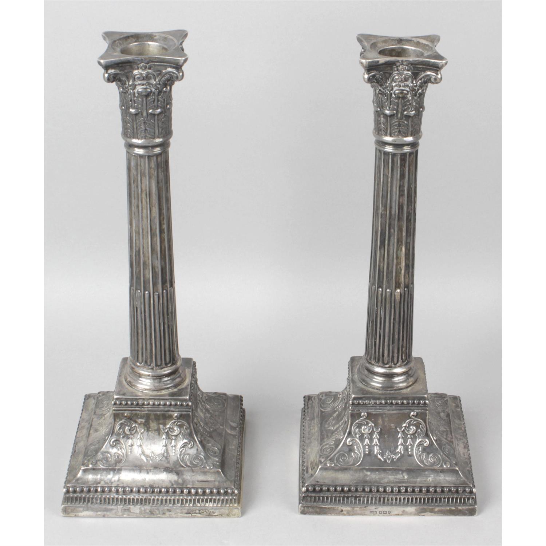 A pair of Edwardian silver classical column candlesticks.