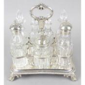 A William IV seven bottle silver cruet stand.