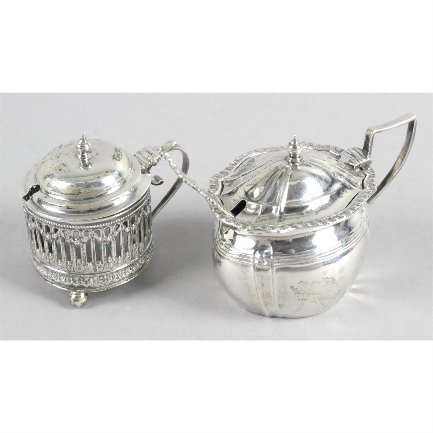 Three early 20th century silver mustard pots, together with a later example. (4).