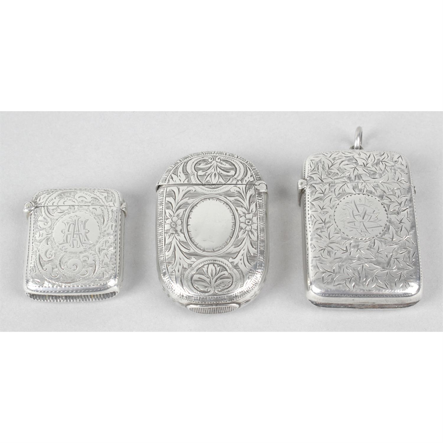 Three late Victorian silver vesta cases, with floral and foliate engraving. (3).