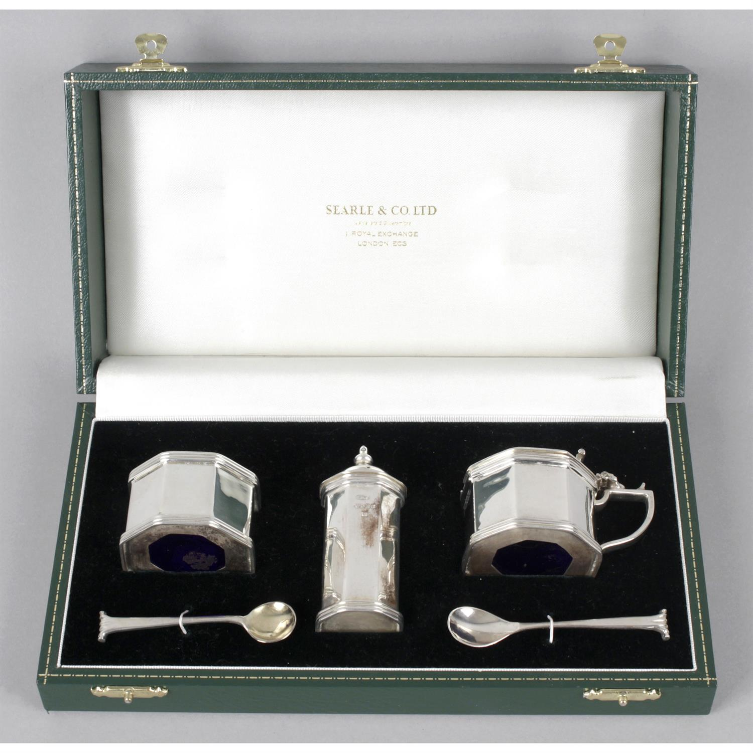 A modern silver three piece condiment set, in fitted case.