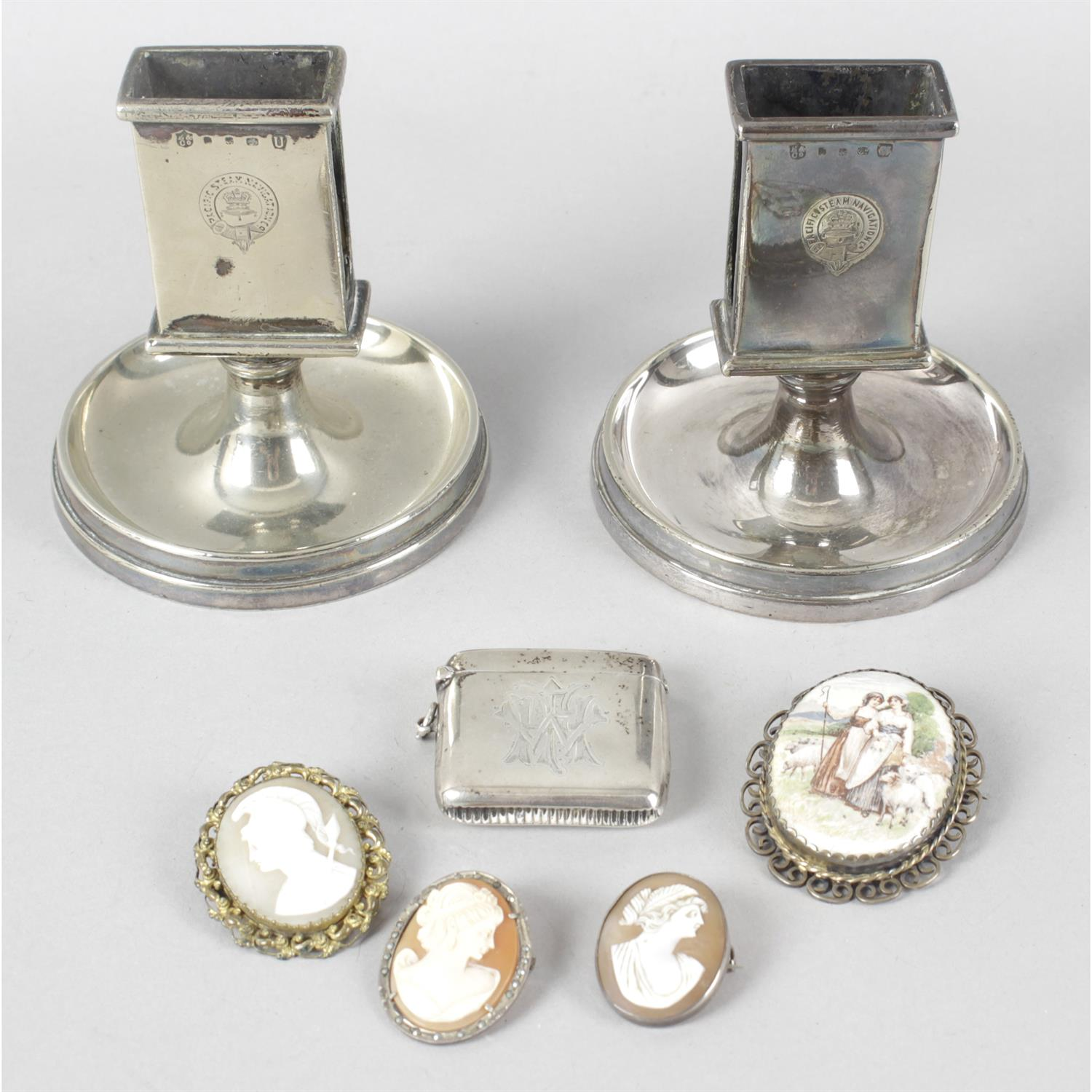 A mixed selection of items to include Pacific Steam Navigation matchbox holders, costume jewellery,