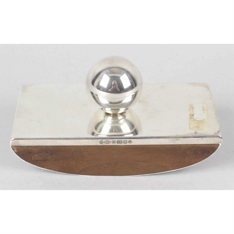 A silver mounted desk blotter.