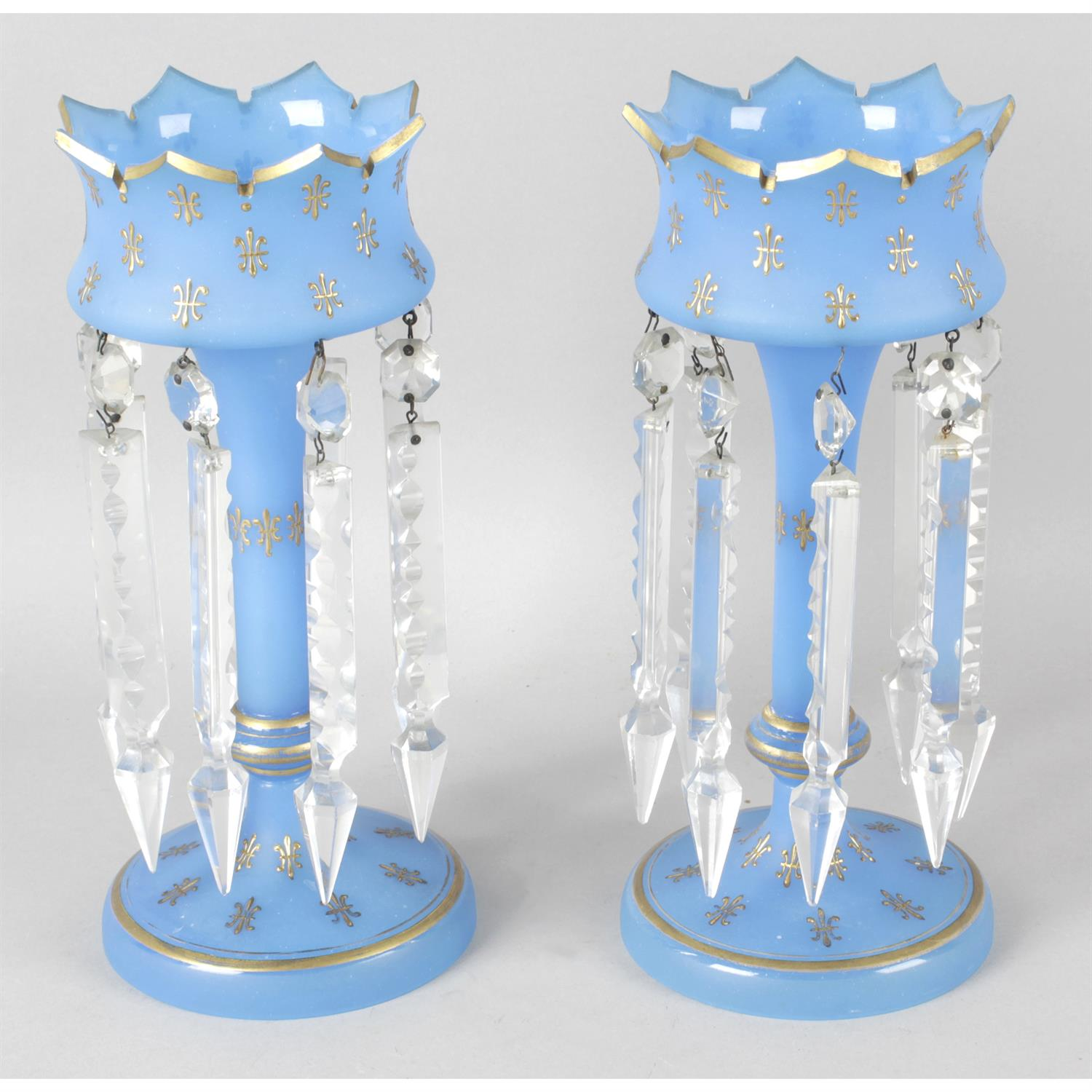A pair of late 19th century blue glass lustre vases.