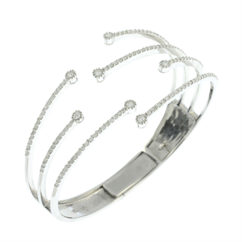 A brilliant-cut diamond open hinged bangle. - Image 3 of 5