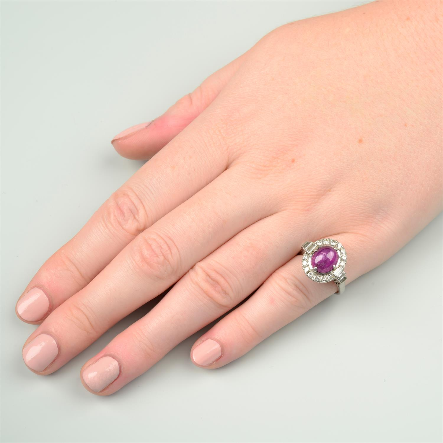A ruby cabochon and vari-cut diamond cluster ring. - Image 6 of 6