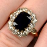 An early 20th century 15ct gold sapphire and circular-cut diamond cluster ring.