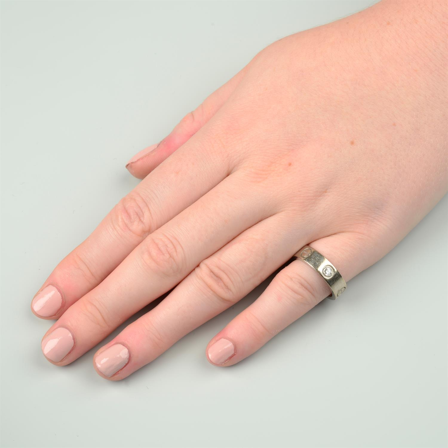 An 18ct gold diamond 'Love' ring, by Cartier. - Image 8 of 8