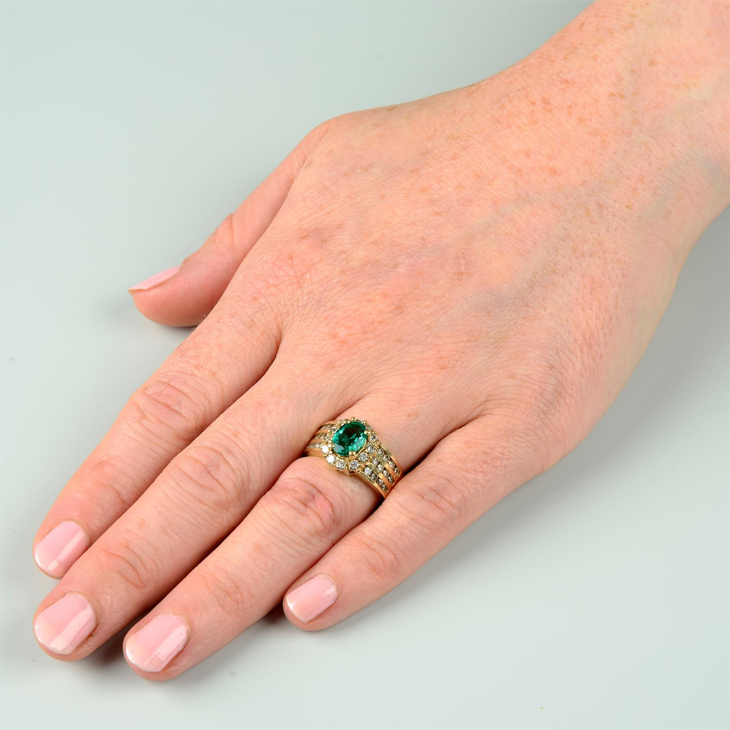 A Zambian emerald and brilliant-cut diamond cluster ring. - Image 7 of 7