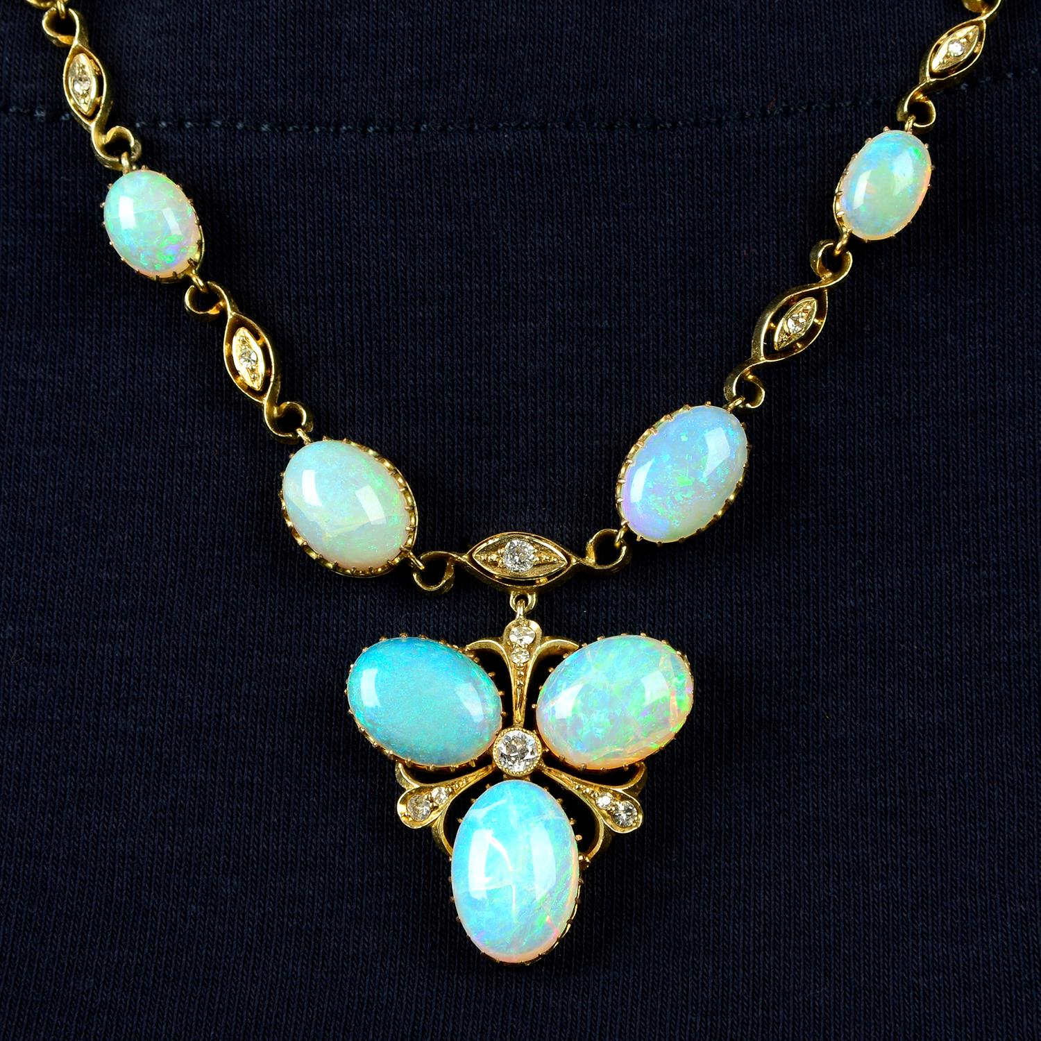 An early 20th century gold opal and diamond necklace, with later back chain.