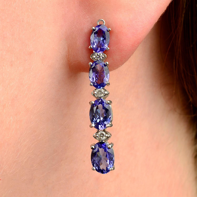 A pair of tanzanite and diamond earrings.