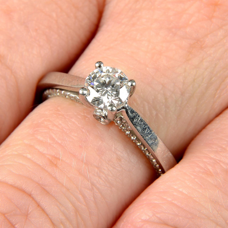 A platinum brilliant-cut diamond single-stone ring, with brilliant-cut diamond gallery.