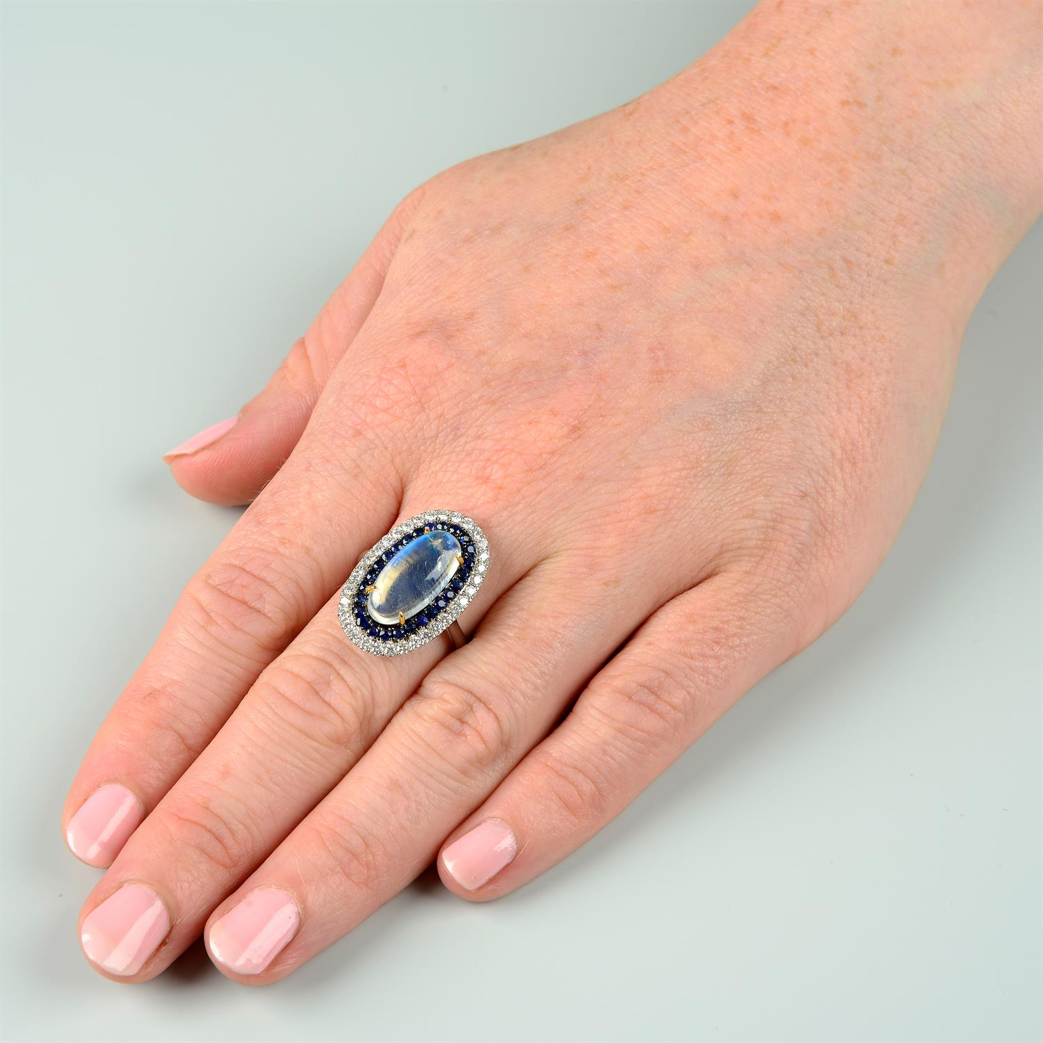 A moonstone, sapphire and diamond ring. - Image 6 of 6