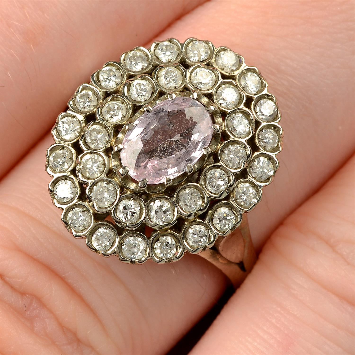 A pink sapphire and brilliant-cut diamond stepped cluster ring.