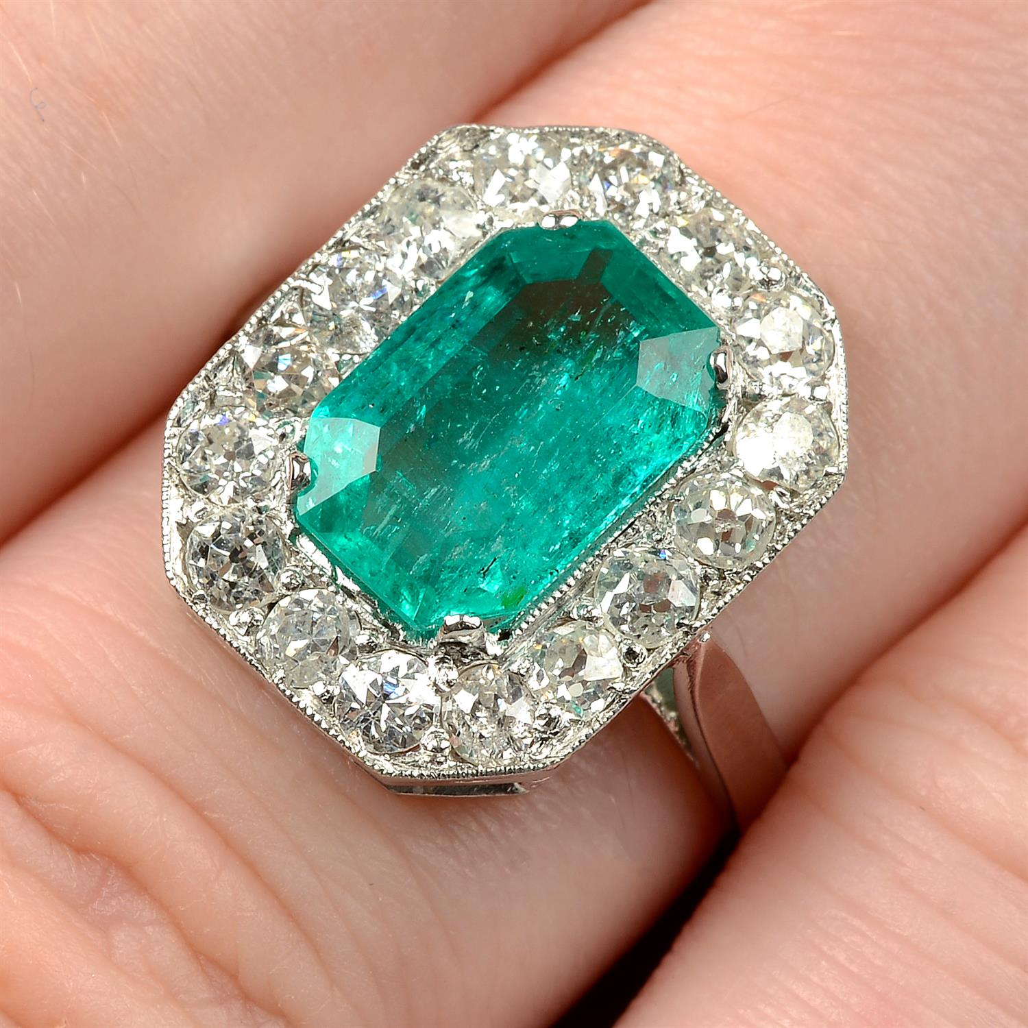 A Colombian emerald and diamond cluster ring.