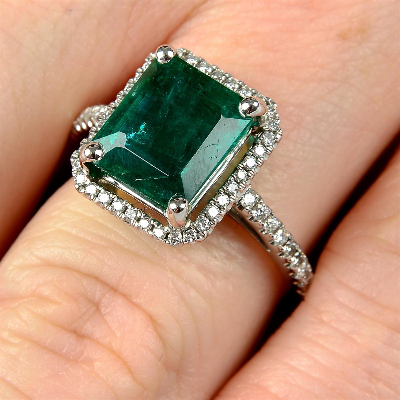 An emerald and brilliant-cut diamond ring.