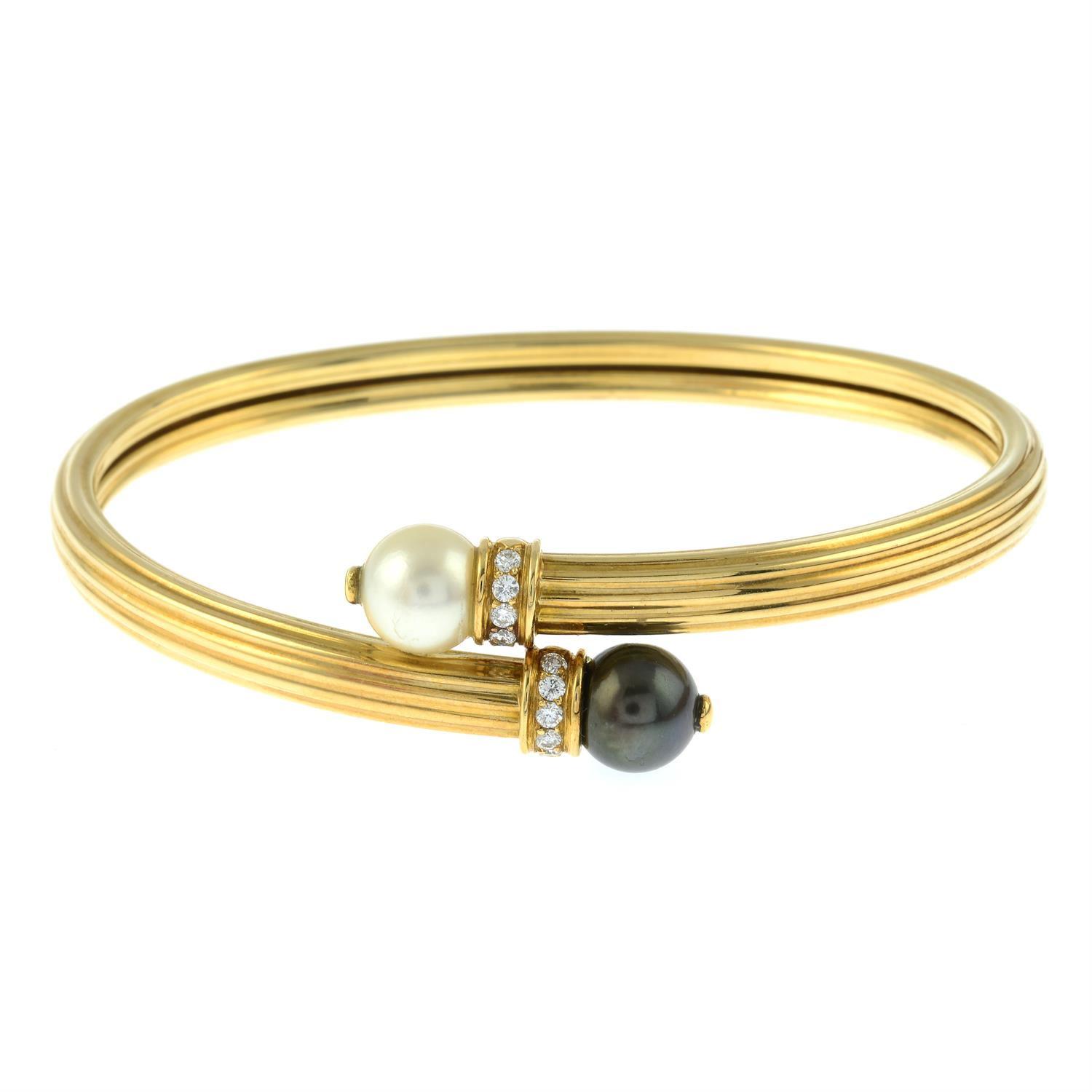 An 18ct gold grooved crossover bangle, with vari-hue cultured pearl and brilliant-cut diamond - Image 2 of 3