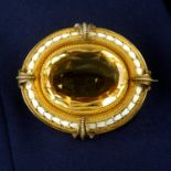 A late Victorian gold, citrine and white enamel brooch, with rope-twist surrounds.