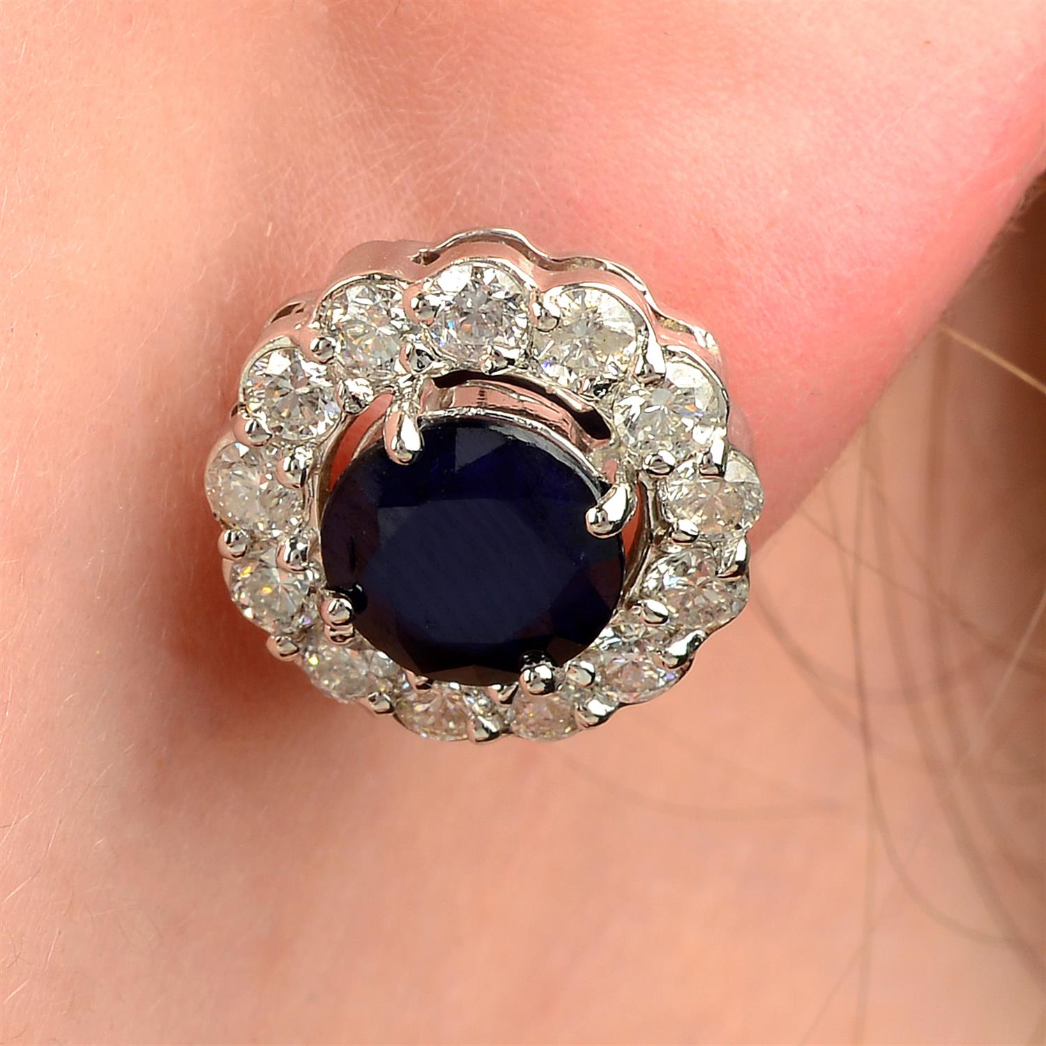 A pair of sapphire and brilliant-cut diamond earrings.