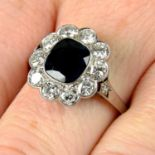 A mid 20th century sapphire and circular-cut diamond cluster ring.
