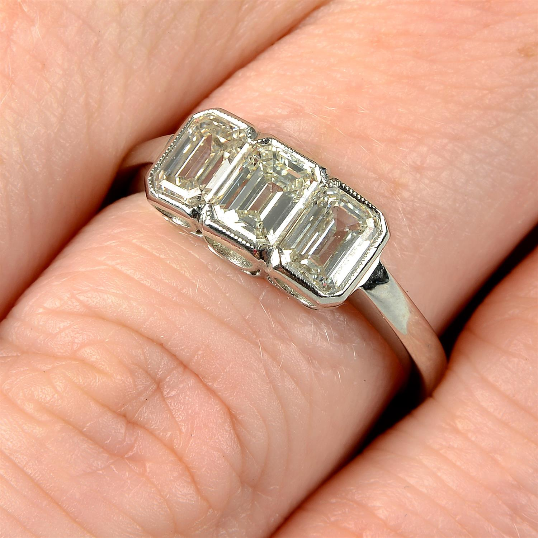 A rectangular-shape diamond three-stone ring.