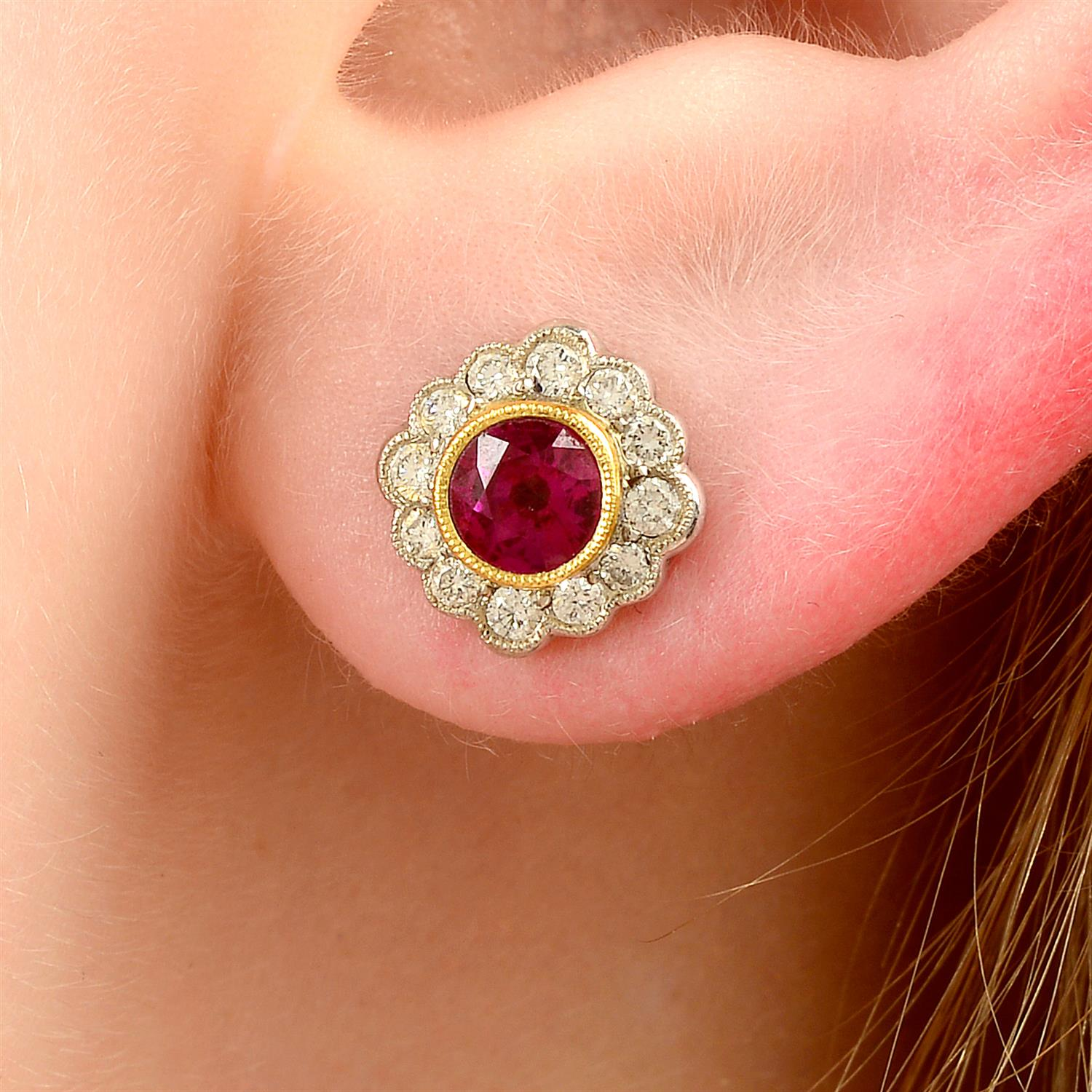 A pair of 18ct gold ruby and diamond floral cluster earrings.