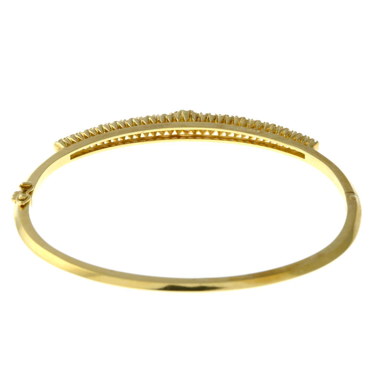 A graduated brilliant-cut diamond hinged bangle. - Image 3 of 4