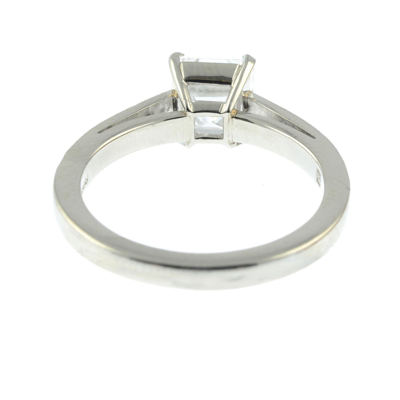 A platinum rectangular-shape diamond single-stone ring, with brilliant-cut diamond line shoulders. - Image 4 of 8