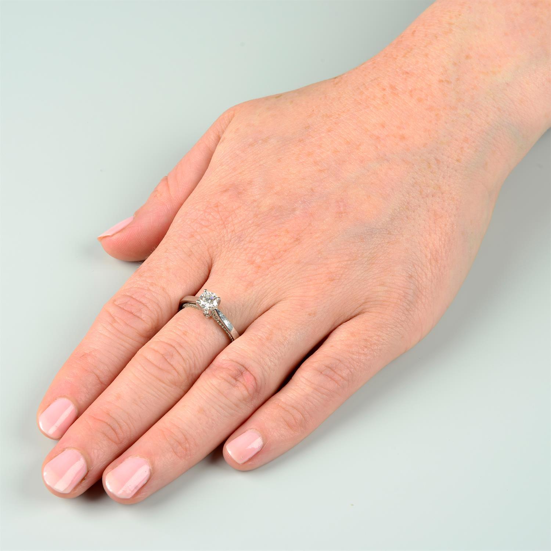 A platinum brilliant-cut diamond single-stone ring, with brilliant-cut diamond gallery. - Image 8 of 8