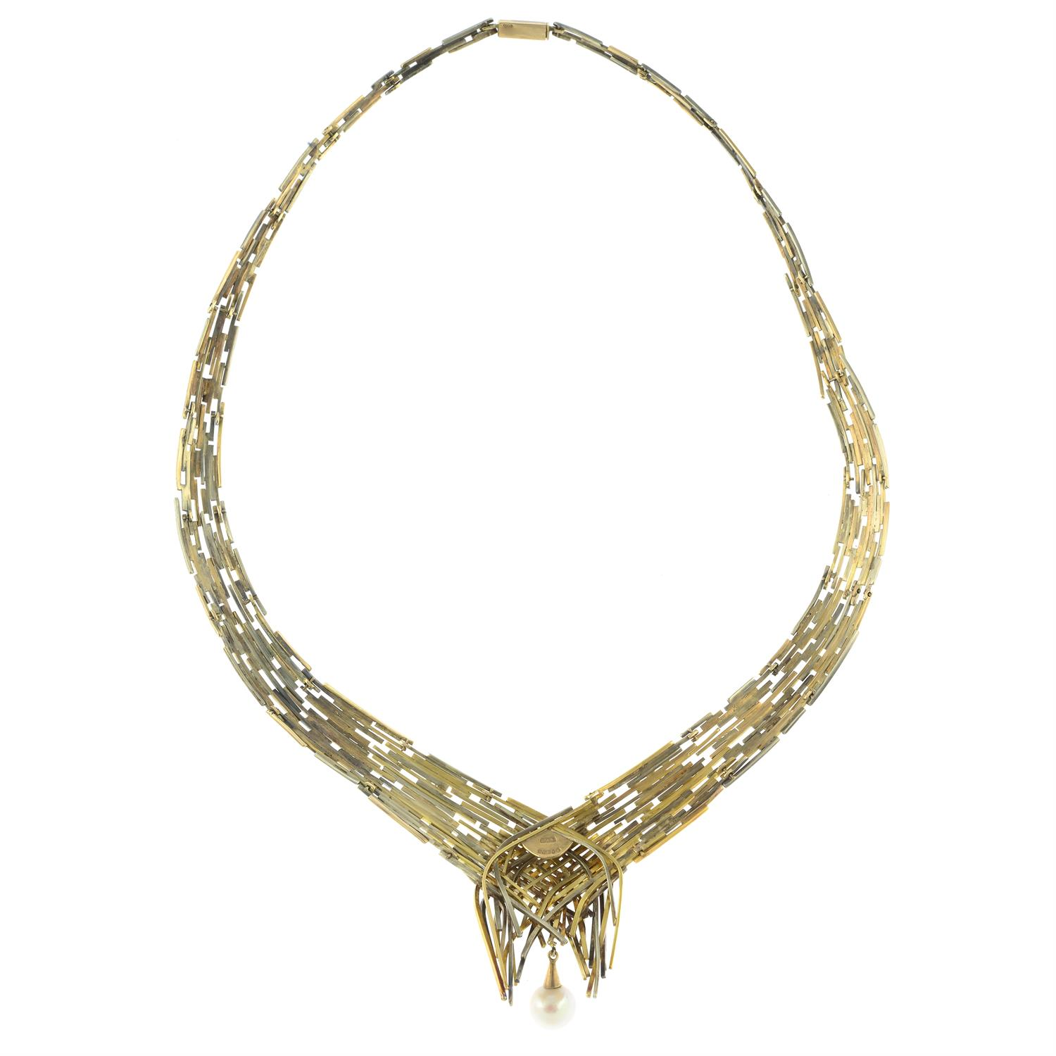 A 1960s tri-colour 9ct gold 'Boyd' articulated collar necklace, with interchangeable green - Image 4 of 7